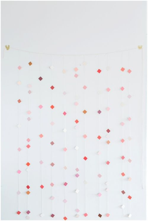 This amazingly simple-to-DIY backdrop is made from paint chips and would be so awesome as a ceremony backdrop or behind a cake table.
