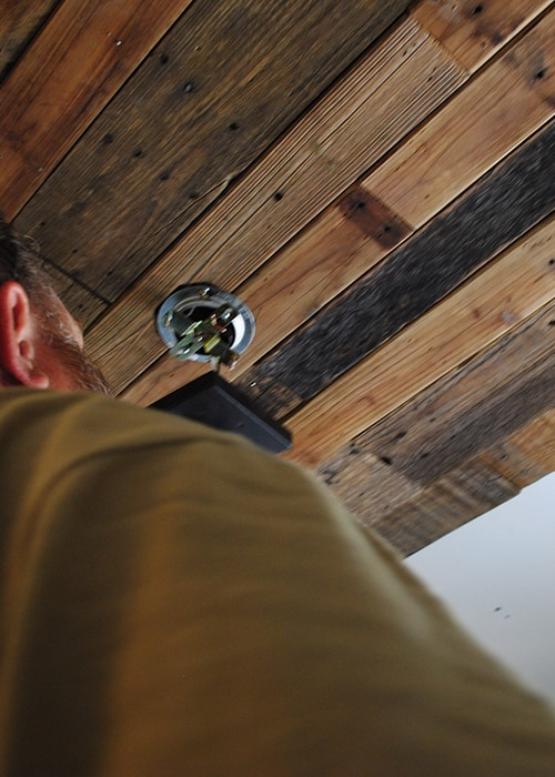 San Antonio lifestyle blogger, Cris Stone, shares a tutorial showing how to DIY a rustic farmhouse ceiling from old wooden pallets. Find out more!