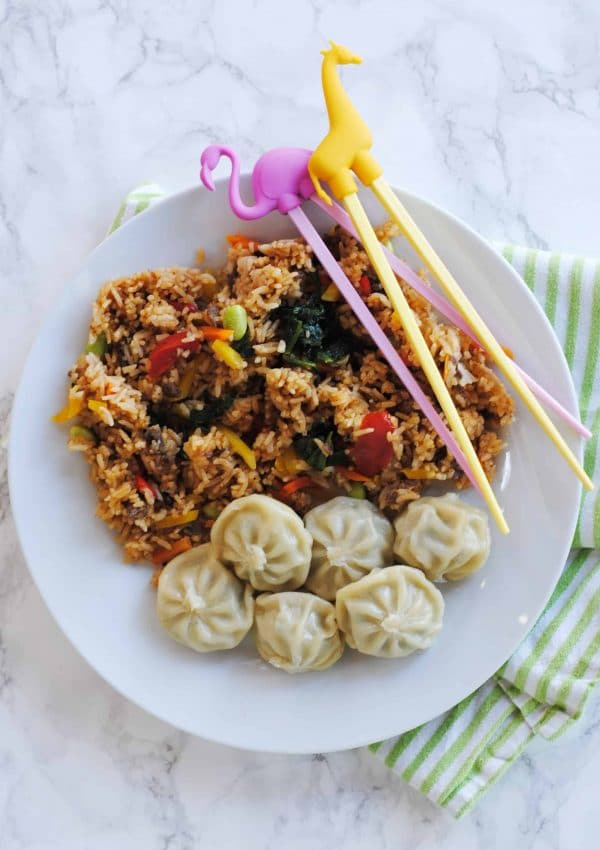 Here's a few of my tips on ways to develop adventurous eaters (plus, a starter recipe for fried rice and steamed dumplings). #LingLingFriedRice #IC #ad