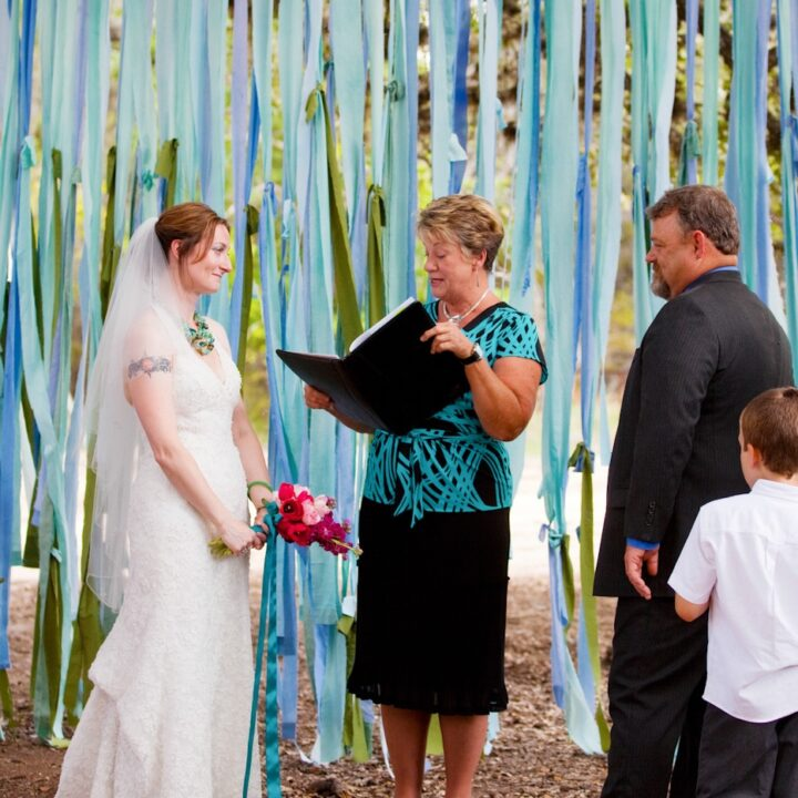 How To DIY A $10 Fabric Backdrop For Your Wedding Ceremony